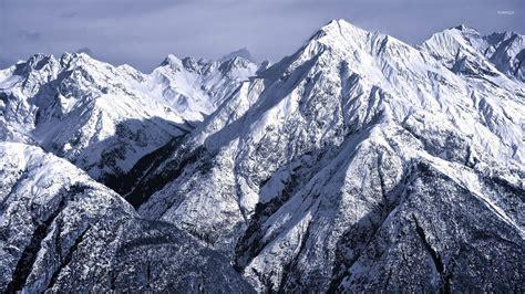 Mountain To Mountain snowy rocky mountains wallpaper nature wallpapers 36084