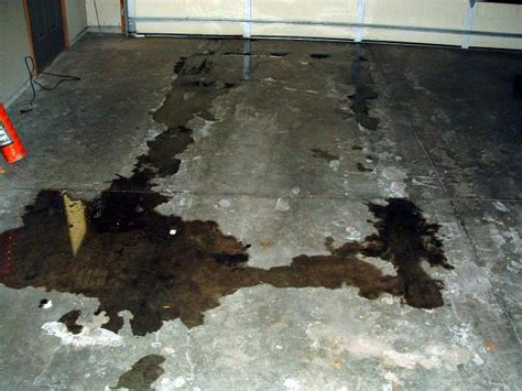Removing Oil Stains in the Garage   Outboard Motor Oil