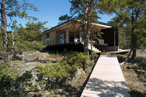 Contemporary Cabin a small contemporary cabin designed for a rocky coastline