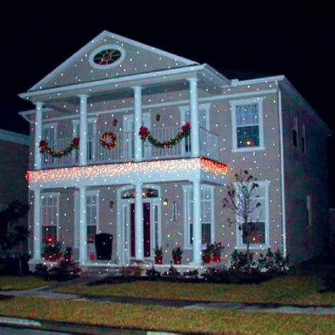 christmas lights projected on house light flurries projector creates the illusion of snow falling on your house operation gadget