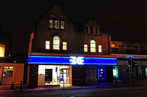halifax bank liverpool robbers burst into merseyside bank through roof in