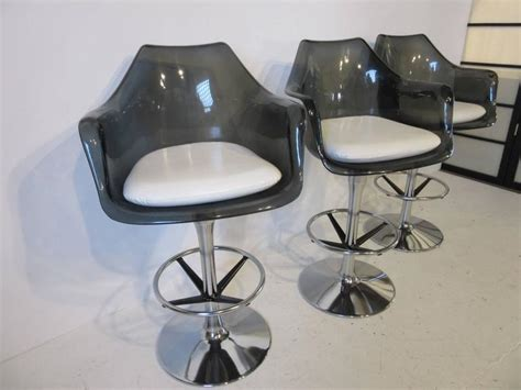 smoked lucite and chrome swiveling bar stools for sale at