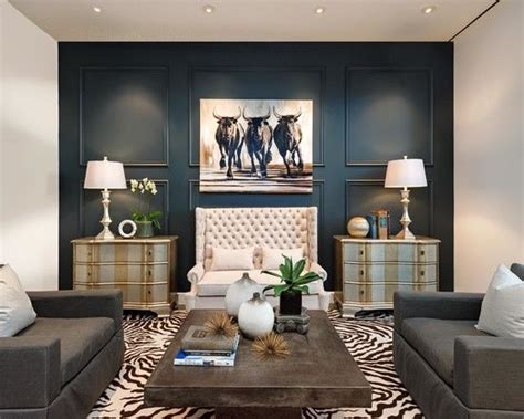 painting accent walls in living room living room animal print rug cow art navy wall wood