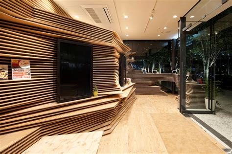 wood interior multipurpose creative space in tokyo by kengo kuma and