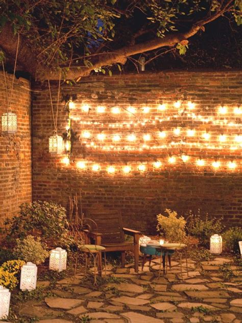 outdoor wall decor ideas with wood plants and lights