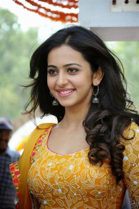 sarinodu movie only rakul preet sing photos rakul preet singh showcasing her firm figure in yellow
