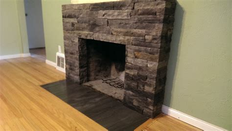fireplace with veneer facing and ceramic tile hearth