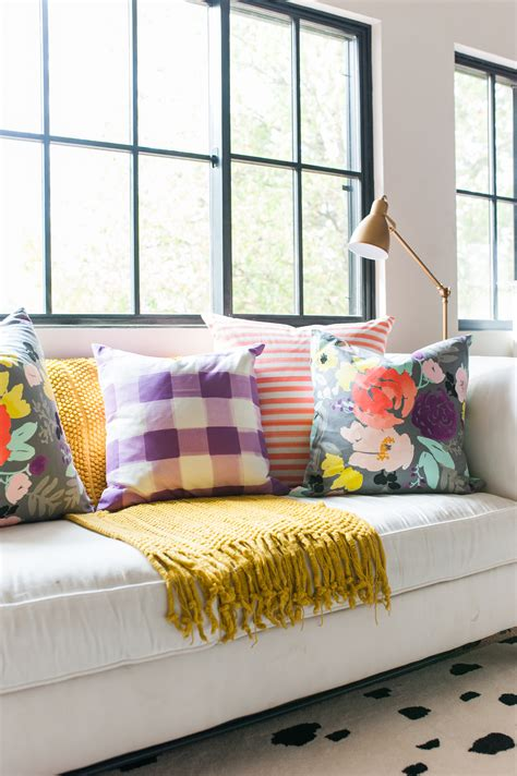 white sofa with colorful pillows caitlin wilson