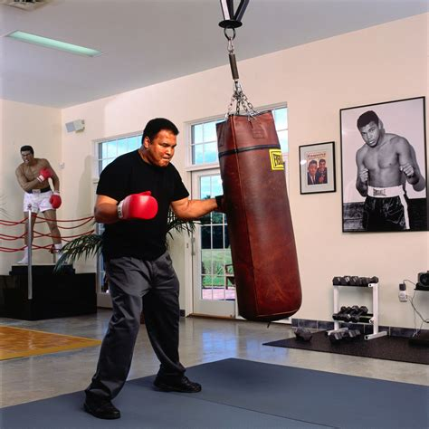 ali hitting heavy bag in his home neil leifer