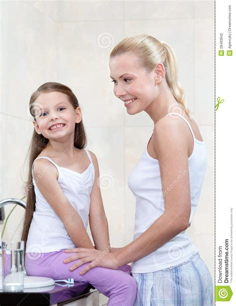 bathroom mother mother and daughter are in bathroom stock photography