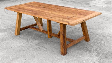 wormy chestnut dining table reclaimed by brandmojointeriors