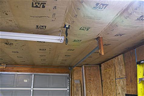 insulation for garage ceiling how to install kraft faced fiberglass insulation in a garage ceiling with roof trusses