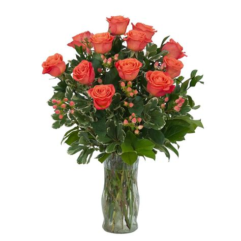 Arranging Roses In A Vase by Orange Roses Berries Vase Arrangement Seasons Floral