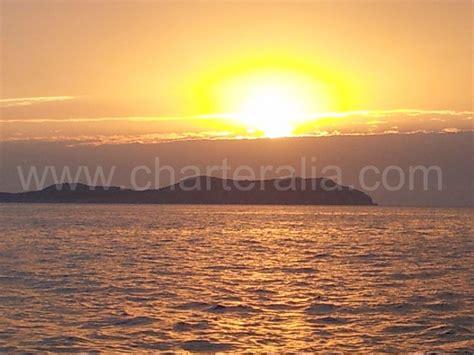 isla conejera puesta sol alquiler barcos ibiza - Conejera Velero