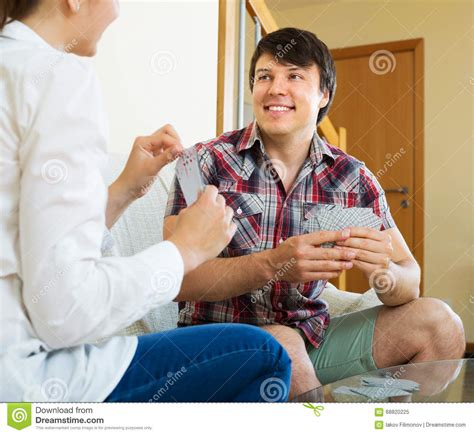 young couple room young couple playing cards stock photo image 68820225