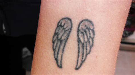 small angel wings tattoos designs