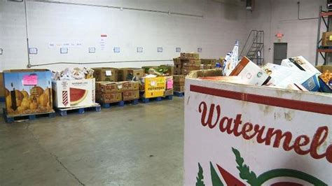 business presents check to greater lansing food bank fox