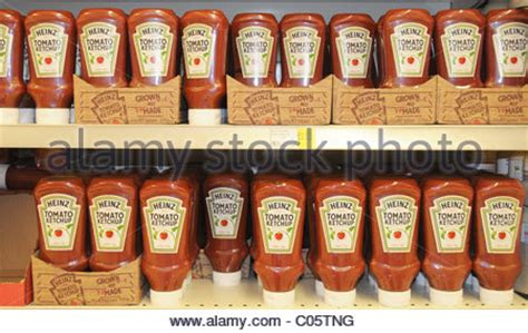 Shelf Of Ketchup by Bottles Of Heinz Tomato Ketchup On A Supermarket Shelf