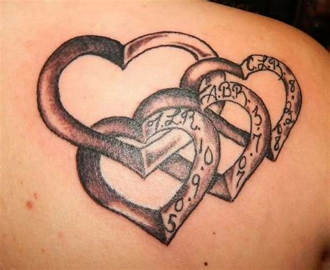 heart tattoos with names in them with hearts of your children hanging of