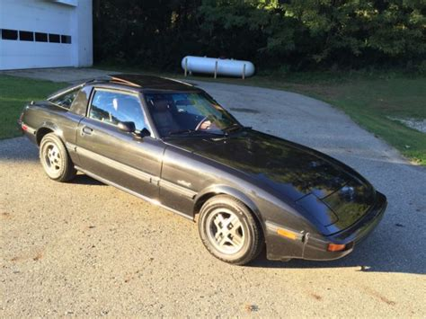 car manuals free online 1985 mazda rx 7 electronic toll collection service manual 1985 mazda rx 7 rear hatch trim panel removal service manual 1985 mazda rx 7