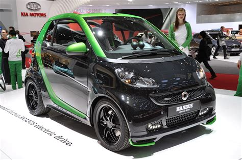 smart car green smart fortwo brabus electric drive is a black and green