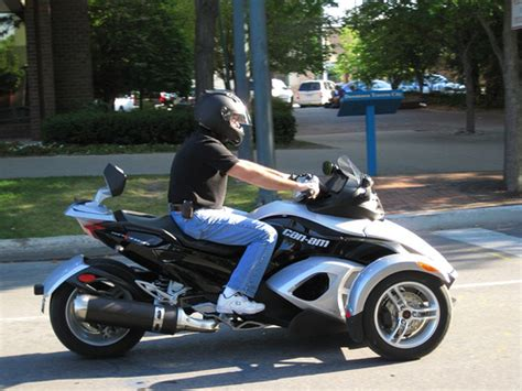 can am spyder roadster trike and owner getting ready to