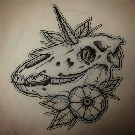 traditional old unicorn skull with a flower tattoo