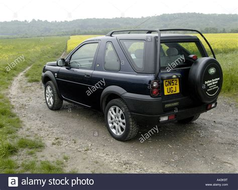 land rover freelander road land rover freelander road in the countryside stock