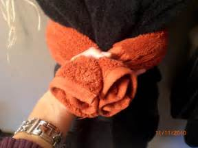 When your hand towel is rolled wrap it around your large bath towel
