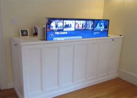 diy tv lift cabinet clever ways to disguise a tv landeelu