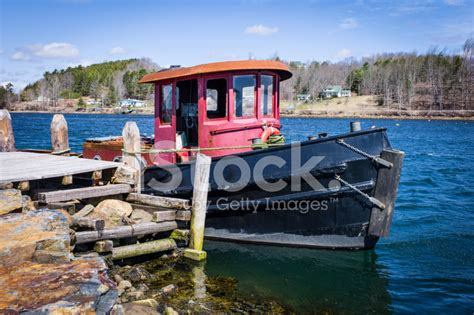 tugboat or tugboat older small tugboat or work boat at a stock photos