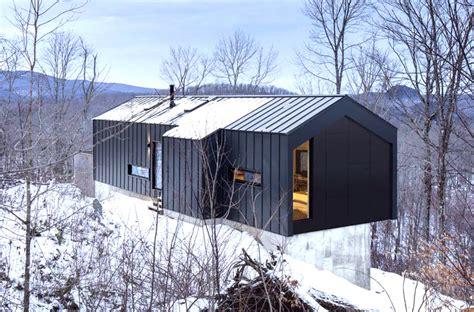 Minimalist steel cabin floats above a rugged slope in