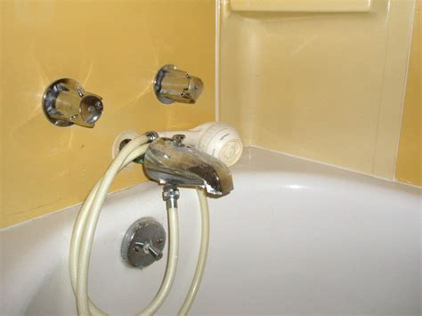 bathtub shower head covert a sink faucet to a hand held shower attach a tub