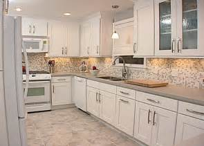 monochromatic modern white maple cabinets with recessed