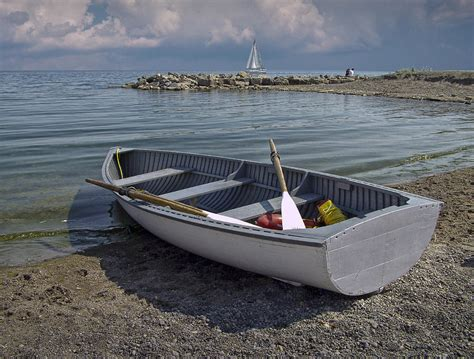 row boat on the beach in toronto photograph by randall nyhof - On A Row Boat