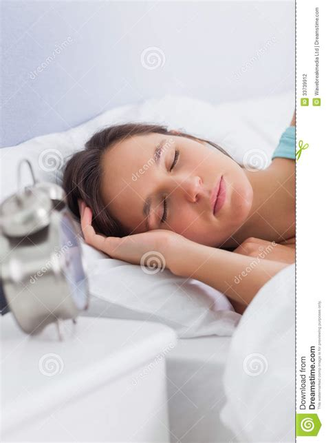 woman sleeping in bed woman sleeping peacefully in bed stock photography image