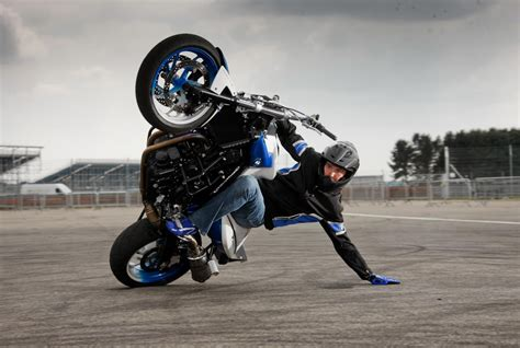 motorcycle riding bmw s new stunt rider in action at goodwood this weekend mcn