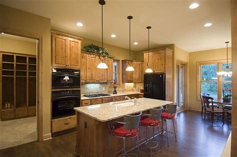 open floor plan kitchen design perfect craftsman house plan the house designers