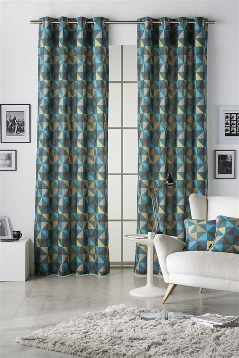 blue lined curtains geometrical pinwheels multi blue lined eyelet curtains
