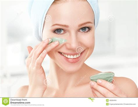 bathroom facial beautiful girl in bathroom and mask for facial skin care