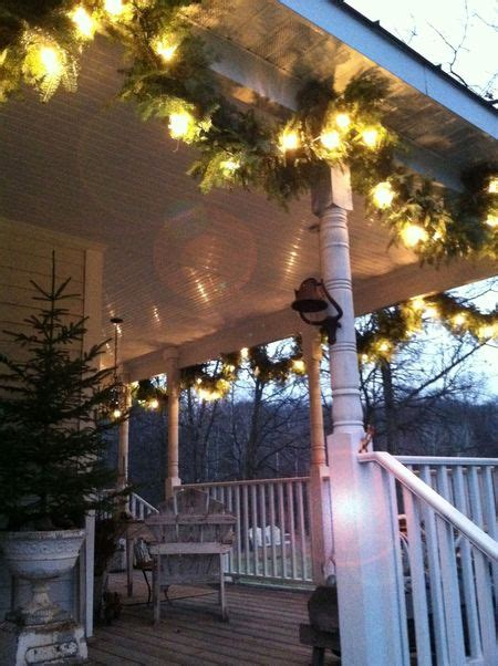 hanging lighted garland on ceiling of covered porch