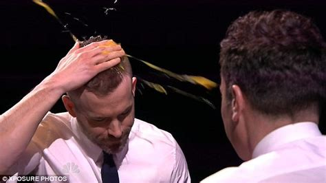 pics of splat head ryan reynolds shows off his competitive side as he takes