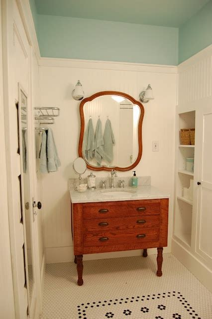 white walls and blue ceiling and vintage bathroom