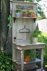 turn an old wood door into a potting bench diy projects