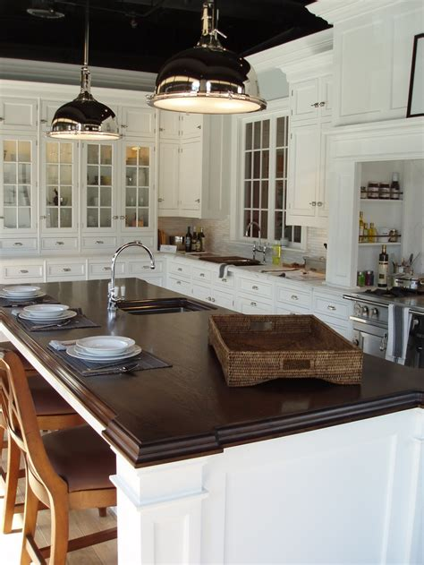 walnut premium wide plank island with elizabethan brown stain cabinets and hardware my