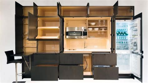 disappearing sleek and polish kitchen design calyx from we ve got you cornered with these cabinet storage