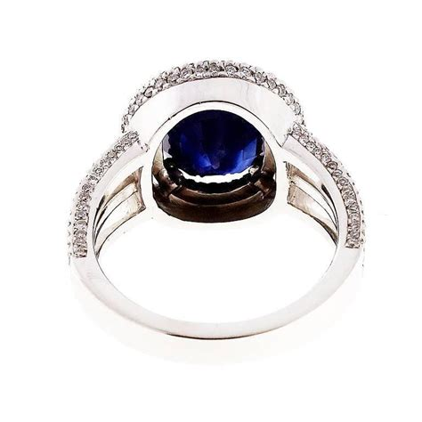 Blue Sapphire Similiar To Royal royal blue sapphire halo ring for sale at 1stdibs