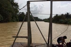one drive the hospice journey of coach estes books a boy fishes from a car ferry on the belize river near