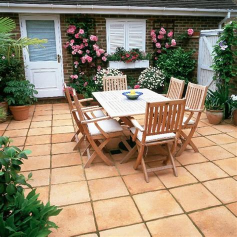 paved courtyard a paved courtyard sits in front of the garage which has been disguised with a