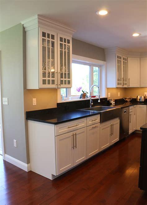 new construction kitchen white kitchen featuring dark cherry island
